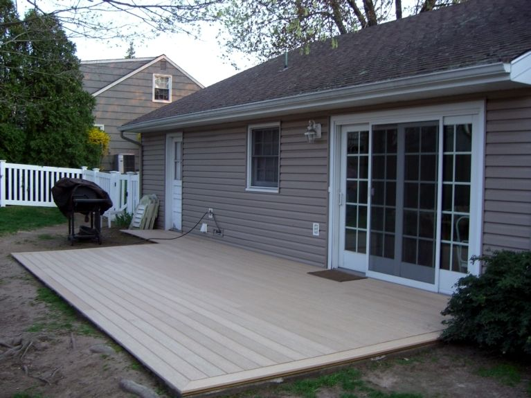 Trex Deck Over Cement Composite Decking From Home Depot Laid Over Existing Concrete Patio Concrete Patio Patio Deck Designs Backyard