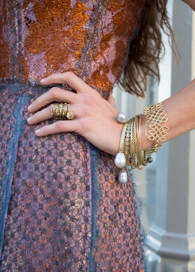 Rustic feel huge baroque pearls dripping off gold bangle!! Ring stack!