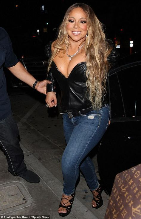 Mariah Carey threatens to spill out of her top at Catch in LA