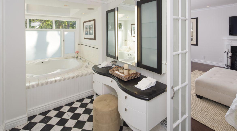 Timeless And Elegant Bathroom With Spa Tub Recces Lighting And Vanity Los Angeles Homes Elegant Bathroom Marlon Brando