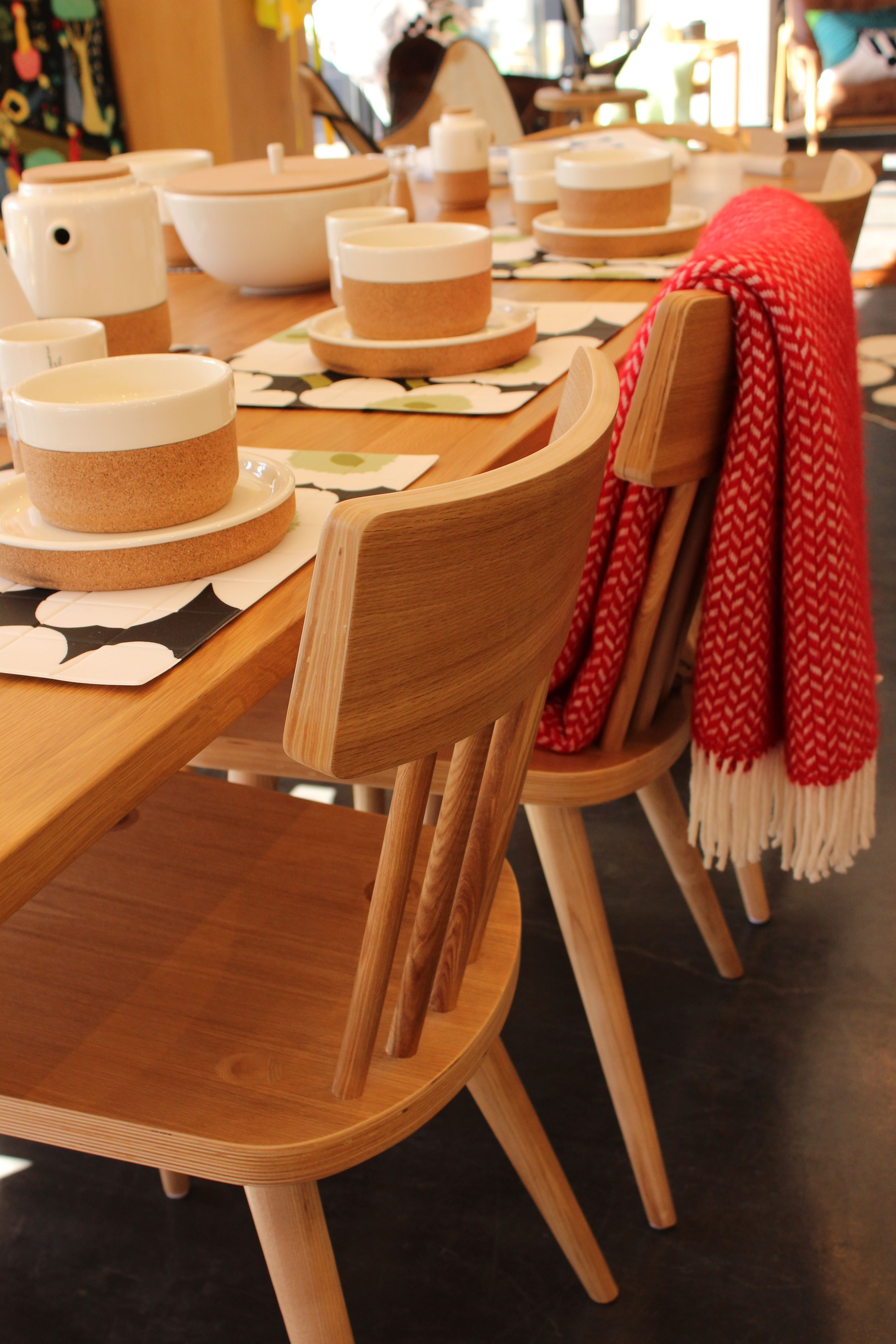 The modern furniture stores 3m extendable dining table and 5 bar dining chairs european oak with some marimekko and cork ceramic tableware