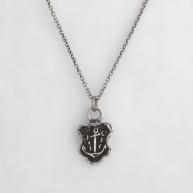 Stability Talisman Necklace. This handcrafted talisman necklace features a dropped anchor in the waves, which is a symbol of safety and security. This talisman reminds us that no matter what is going on around us, we can feel safe and secure.