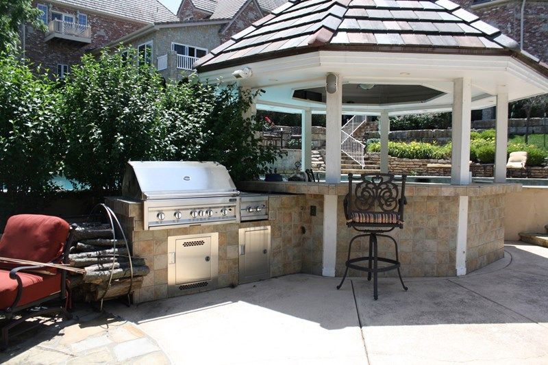 Built in grill covered swim up bar outdoor kitchen turf
