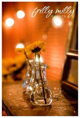 daisies in small vases