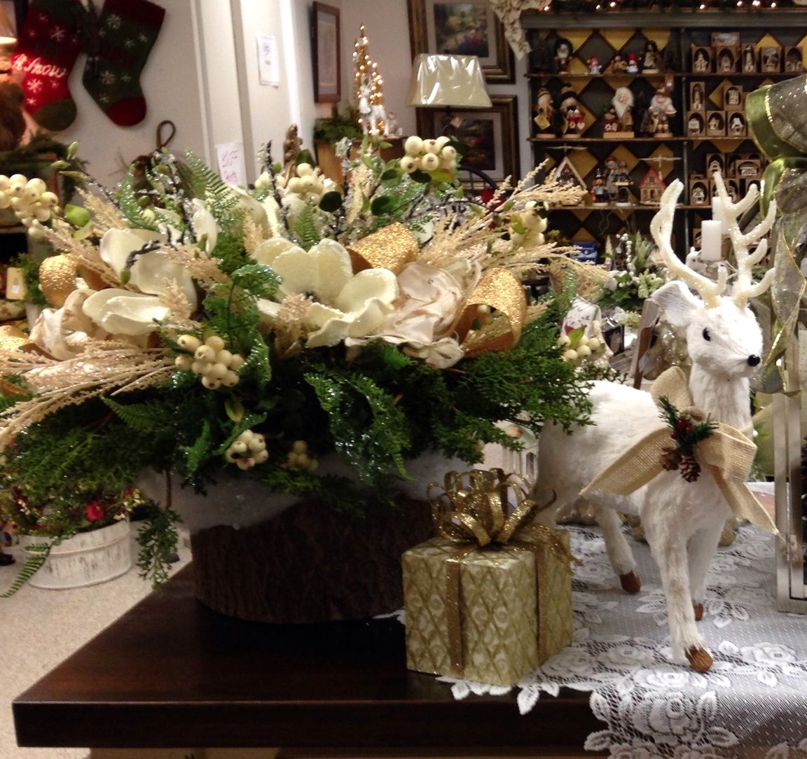 Gold tones adds holiday glamour to this woodland scene.
