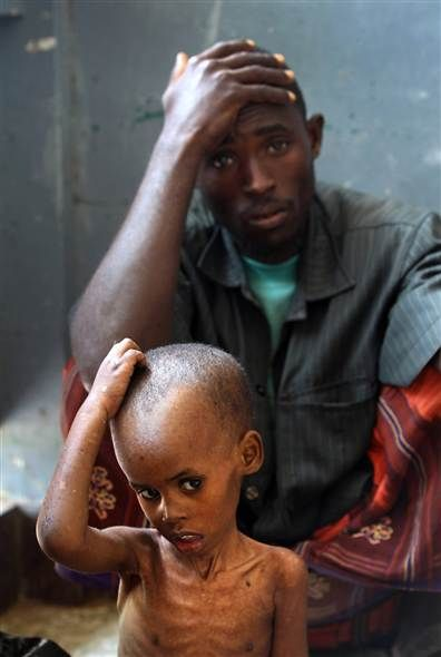 """""""Let my heart be broken with the things that break the heart of God."""" Never forget the suffering of the world, and do all you can to alleviate their pain.      This photo is from MSNBC news on Somali famine; photo credit to John Moore"""
