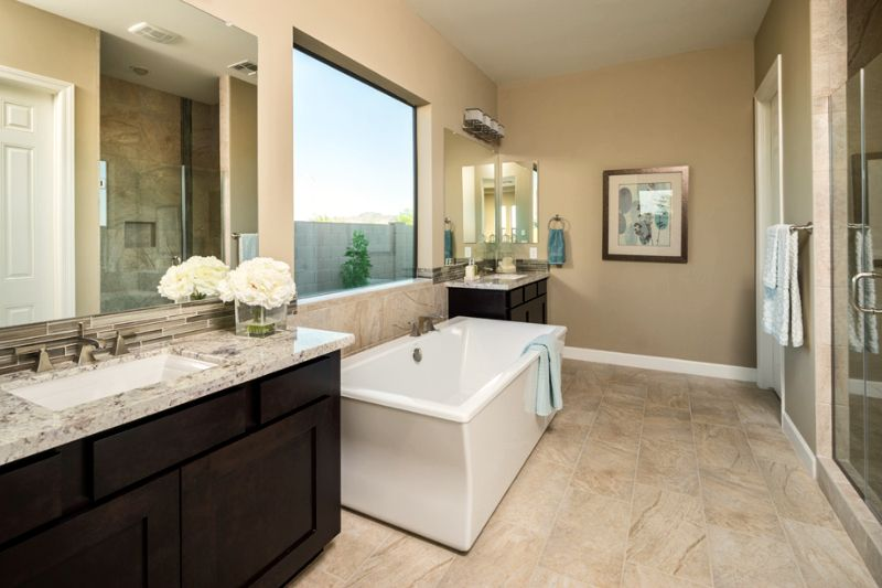 A Spacious Bath Tub In Between His And Her Vanities Toll