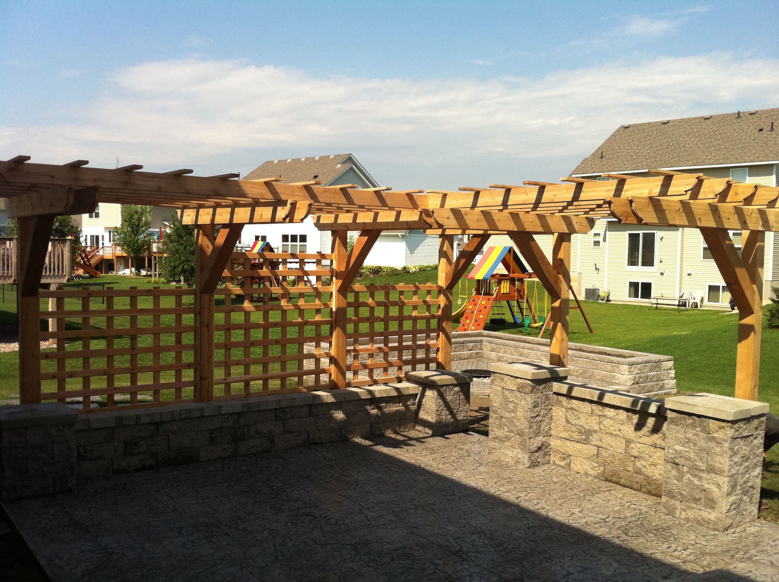 Patio privacy wall ideas - Stamped Concrete Patio With Seating Walls Cantilever Pergola And Custom Lattice For Privacy Great
