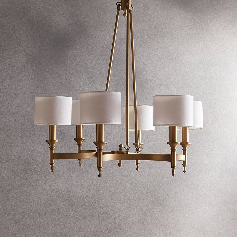 This Chandelier 39 S Aged Brass Frame And Simply Chic Shades Exude Timeless Elegance Traditional Chandelier Chandelier Shades Dining Room Chandelier