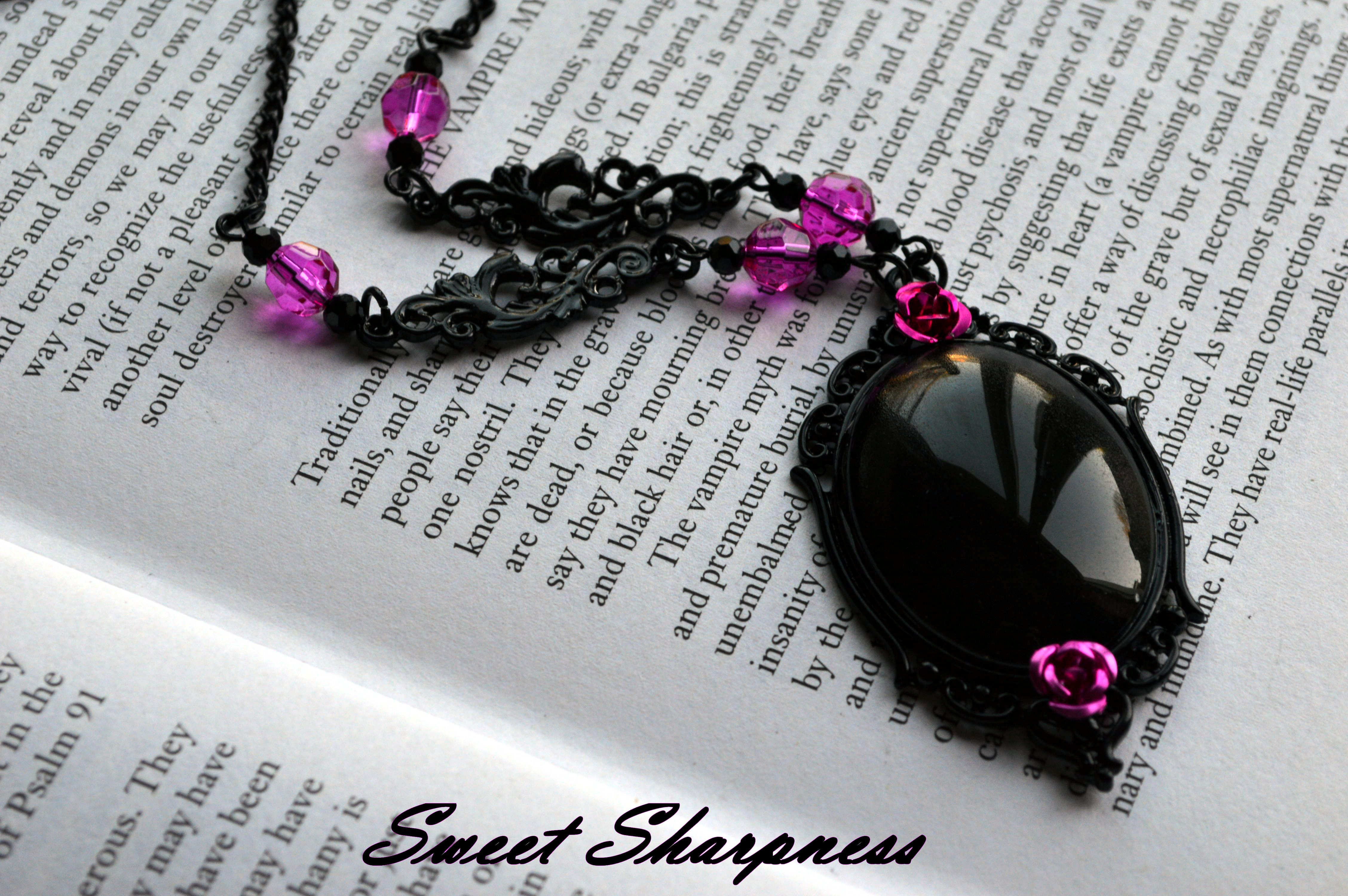 Black and pink glass cameo necklace    www.etsy.com/shop/SweetSharpness