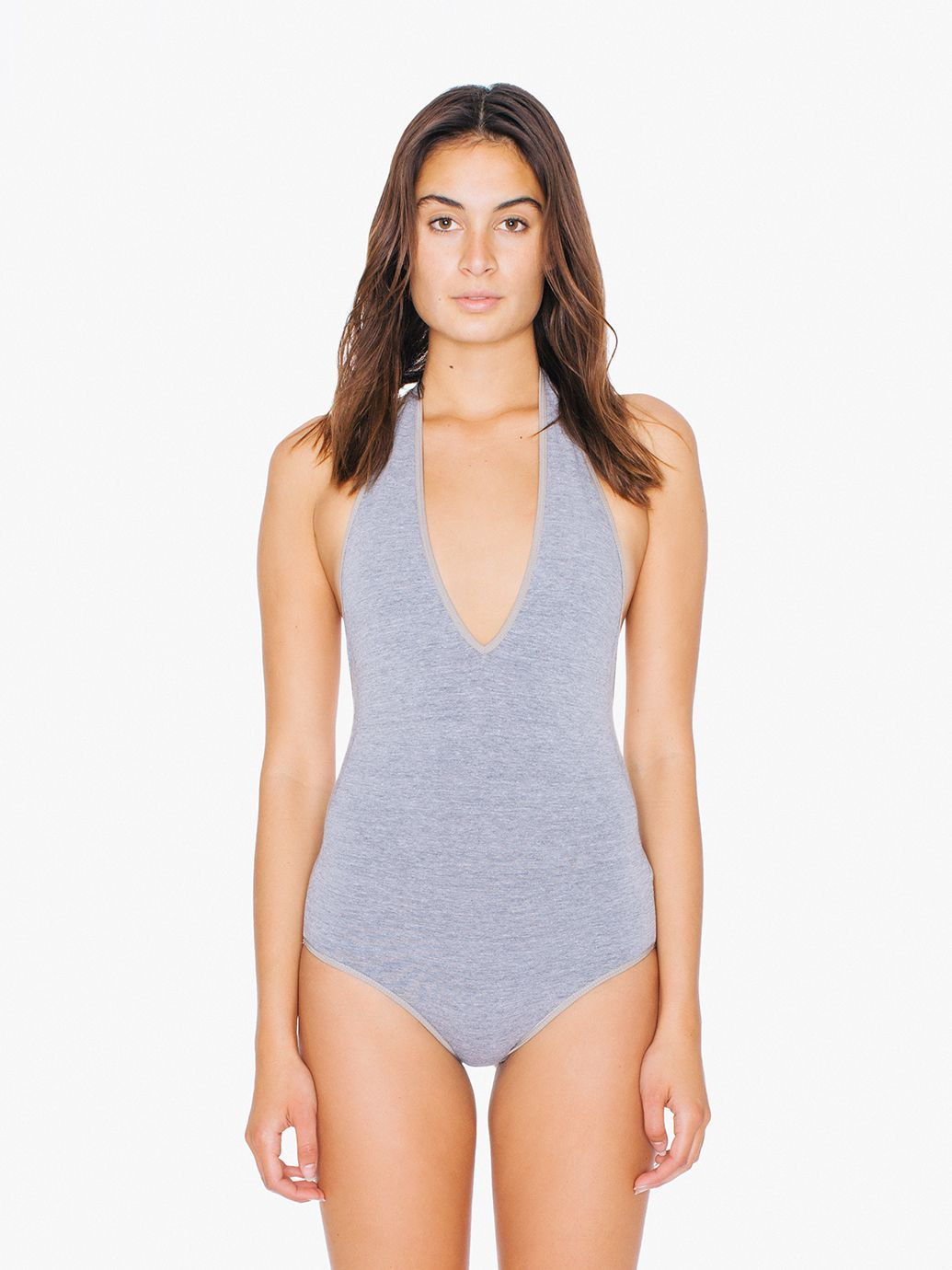 Halter bodysuit featuring a low cut V-neck and open back. In the color black 9f16cf1f8