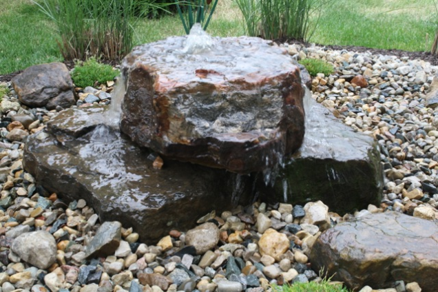 Bubbling rock with hidden reservoir landscaping ideas for Landscaping rocks indianapolis