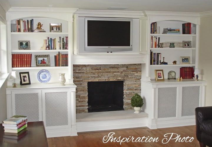 built in cabinets next to fireplace family room