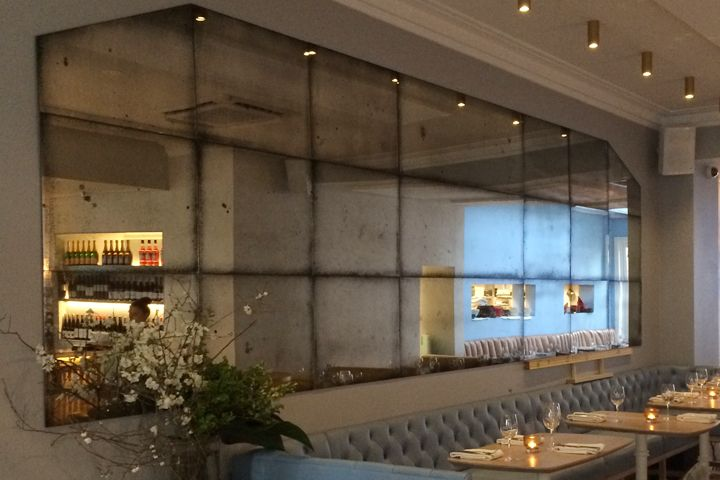 Antique mirror glass feature wall restaurant commercial for Glass mirrors for walls