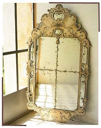 venetian mirror...omg. Love it. But it is a very bad omen to lean a mirror against the wall...hang them