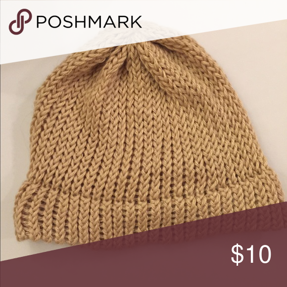 Hand Knit Tan Beanie Hand knit beanie in a tan/camel color. Made from soft yarn handmade Accessories Hats