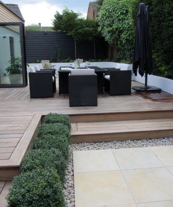I like this clean look of the split level deck modern for Split level garden designs