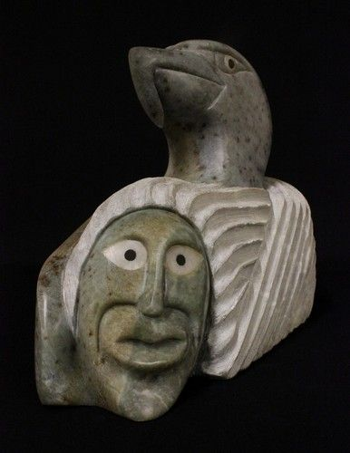 Polished stone carved into eagle head emerging from