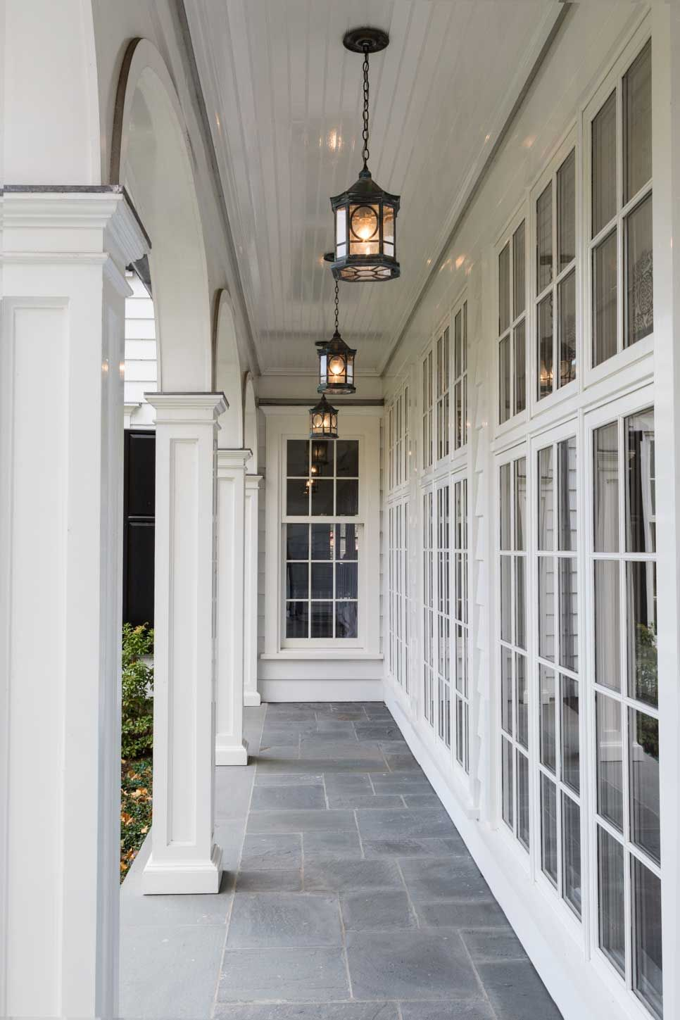 Lovely white porch. The natural light would be amazing