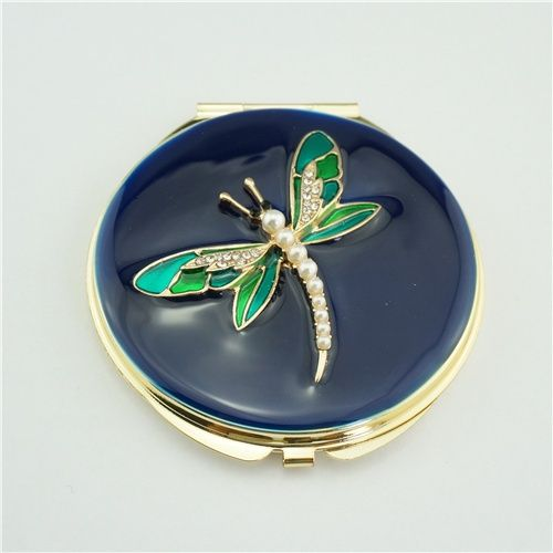 Dragonfly crystal compact mirror/Custom pocket mirrors This enamel dragonfly compact mirror is a perfect gift for lady. It is covered with enamel glaze and mounted with bling-bling crystals. There are two mirrors inside.
