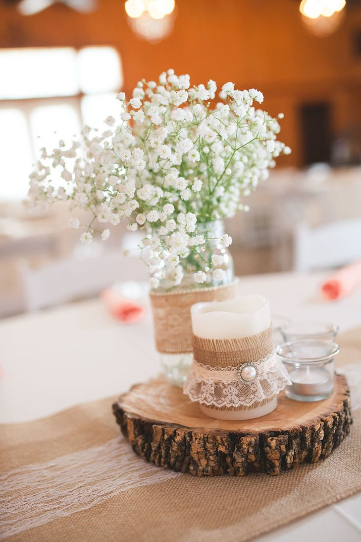 Wooden Slab Centerpiece With Burlap And Lace Striking Stems Designs By Karinda Wooden Slab Centerpiece Bohemian Wedding Centerpieces Wedding Centerpieces