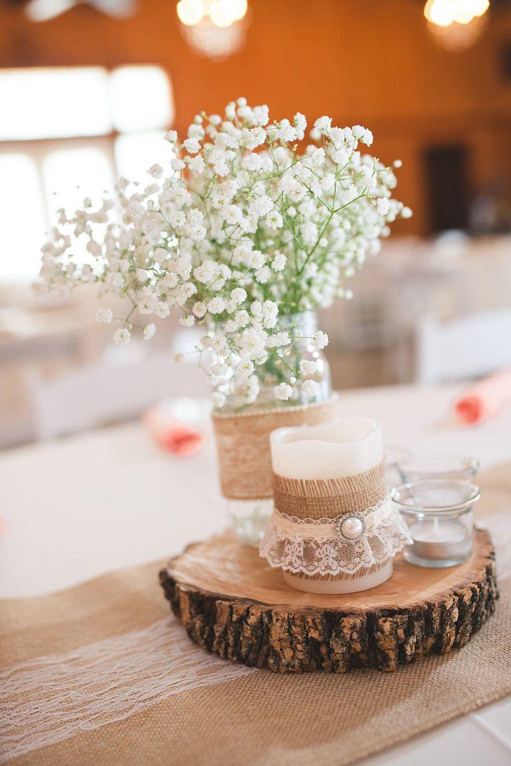 Rustic Burlap Wrapped Jar With Babys Breath On Wooden Slab Wedding Reception Centerpiece
