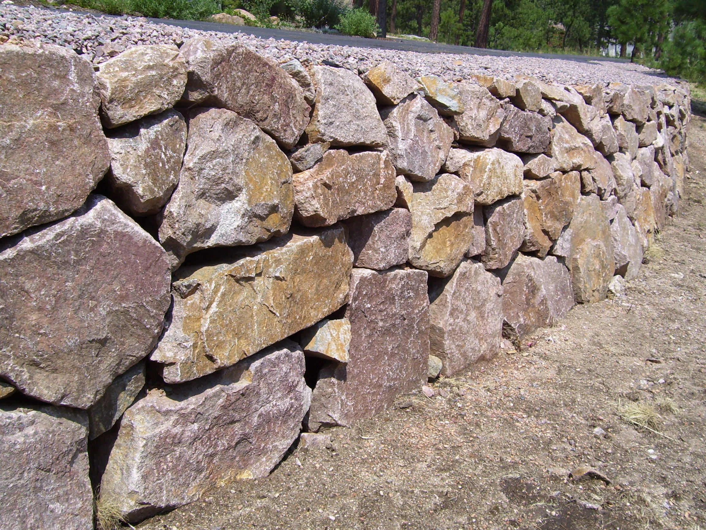 Rock Wall Along Driveway Stone Wall Rock Retaining Wall Natural Stone Wall