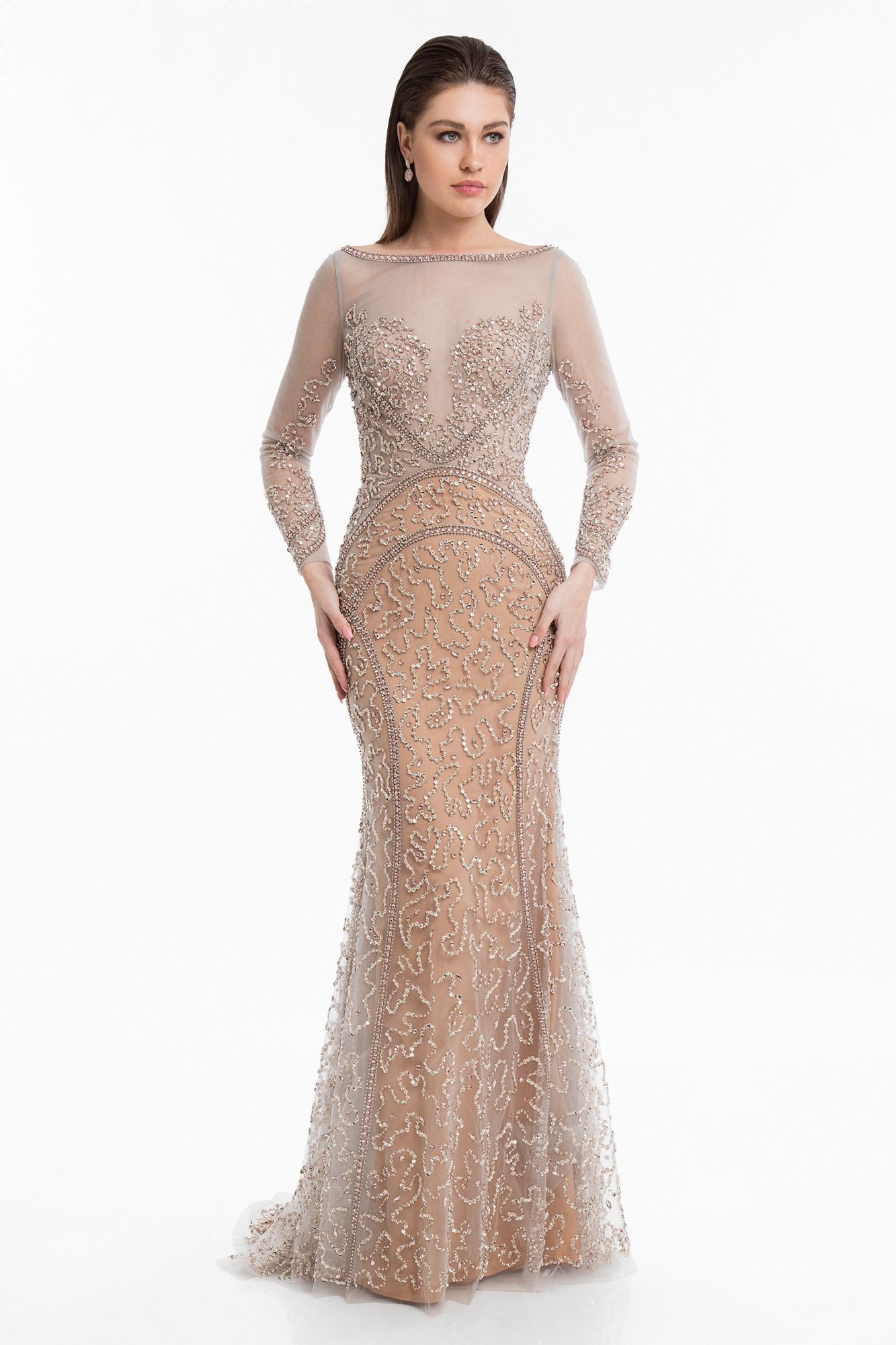 7c9d52ce5f Achieve elegance and glamour in the Illusion Bateau Long Sleeve Embellished  Evening Gown by Terani Couture.