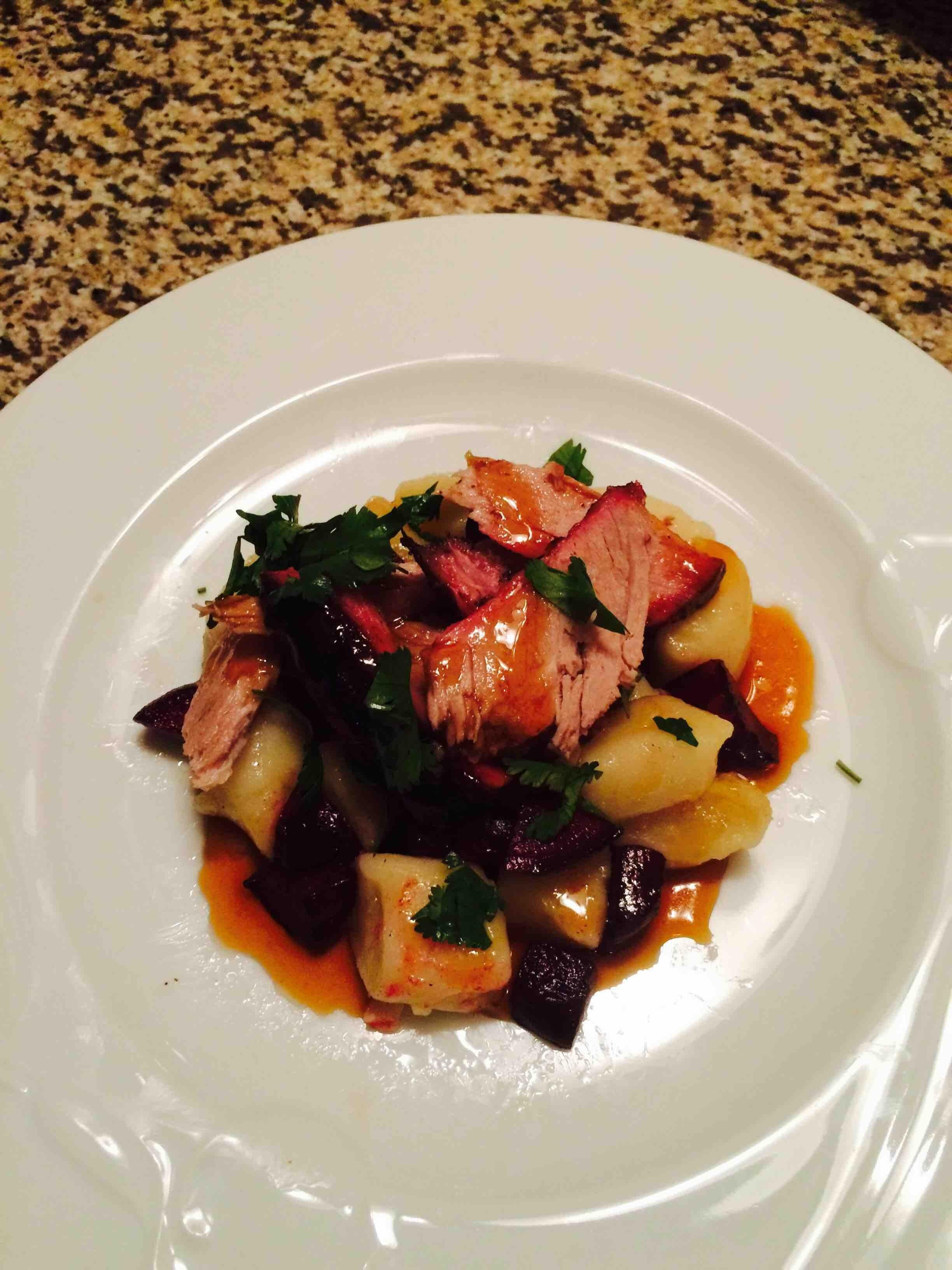 Smoke Pork over gnocchi with pan roasted beets, topped with raspberry sweet n' sour vinaigrette and cilantro...