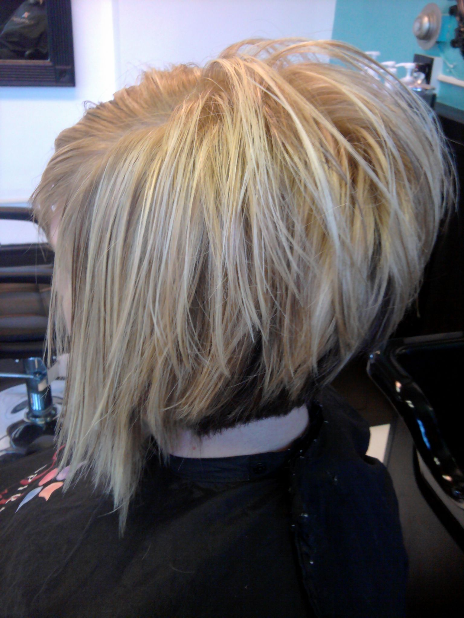 stacked diagonal forward cut with a feather razor. hair by