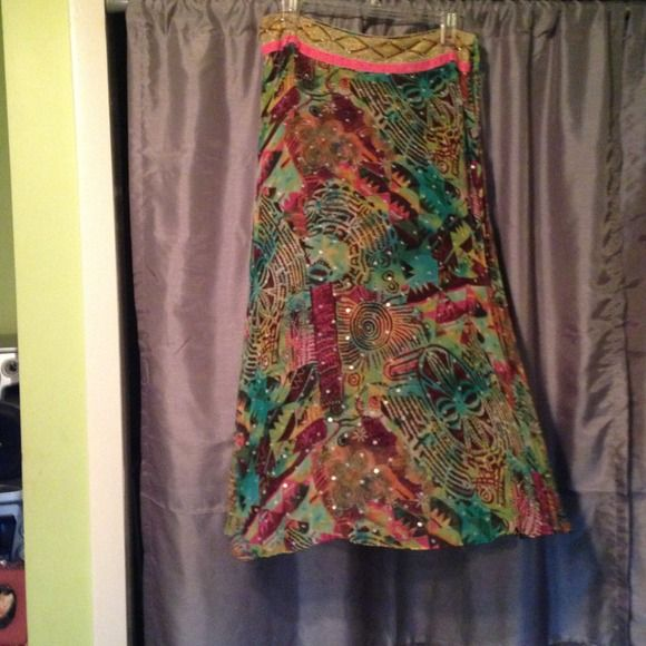 100% silk maxi skirt Multi colored tribal pattern with sequins through out. Gold and pink band around waist. Side tie and zip.  Fully lined. WD. NY Skirts Maxi