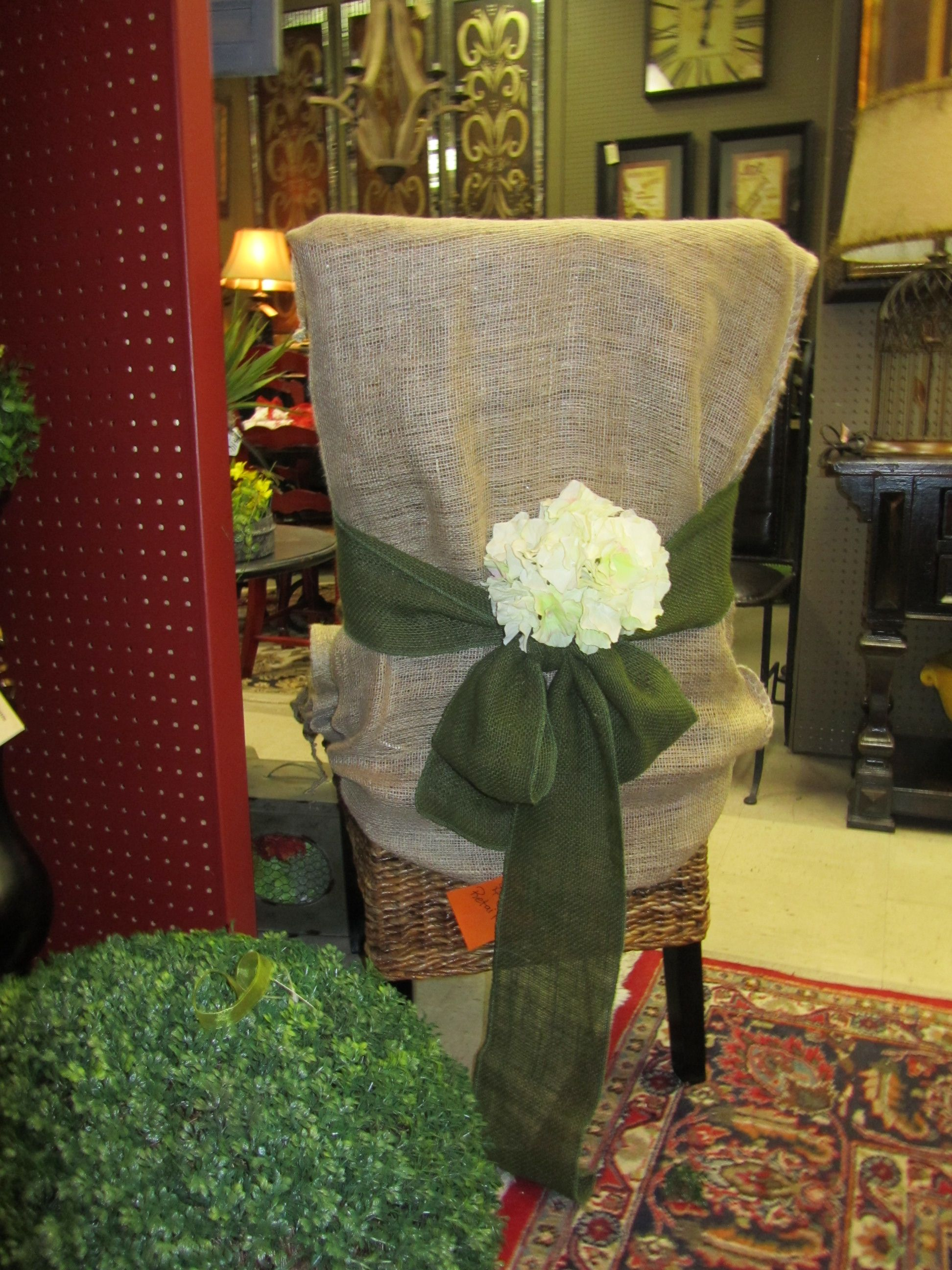 Cover the back of a chair with a plain burlap sack add a