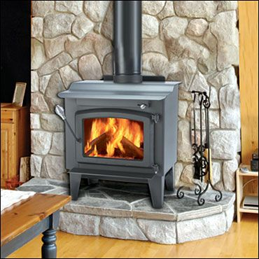 Type Of River Rock Wall Behind Free Standing Wood Stove Idea