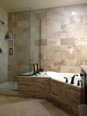 Travertine shower wall stacked stone tub front bathroom for Stacked stone bathroom ideas