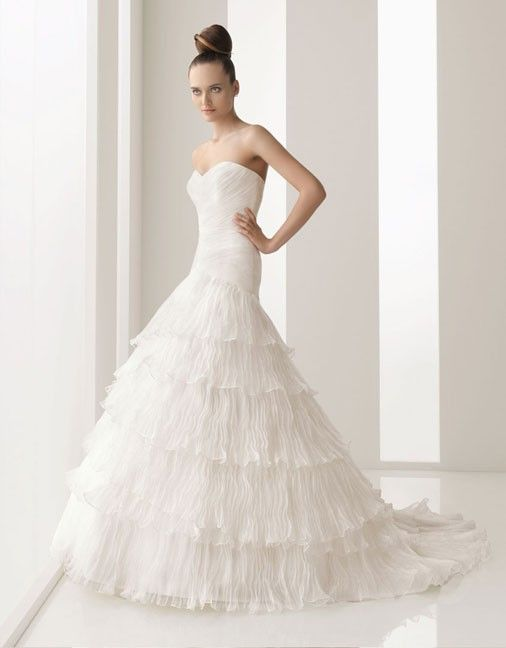 Organza over satin A-line floor length bridal gown with ruffle embellishment