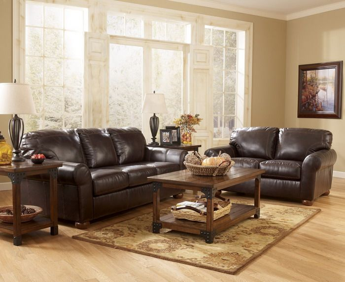 Brown leather living room dark brown leather sofa in for Ashley furniture room planner