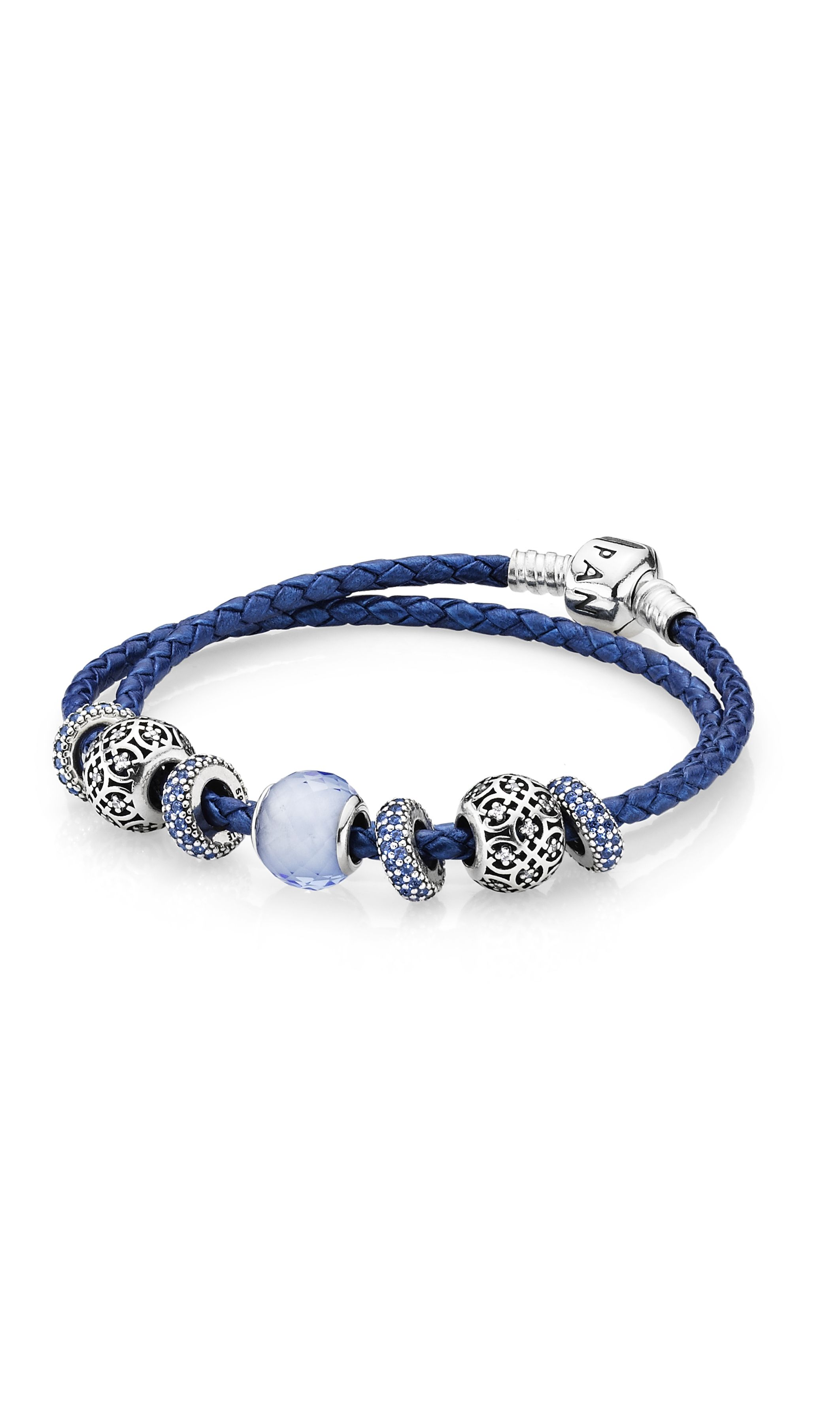 Style the new metallic blue woven leather bracelet with charms in matching blue shades. #