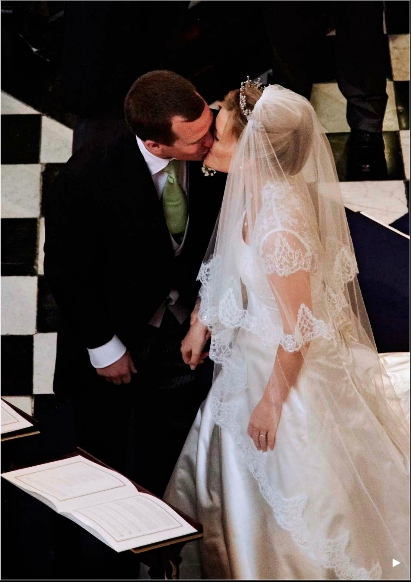 Peter Phillips sharing a kiss with his new wife, Autumnn ...