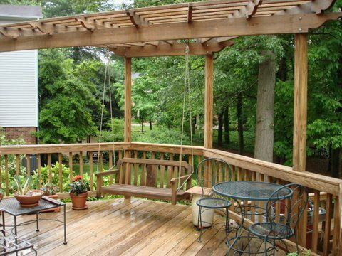 The Southern charm of the swing with a modern twist under a pergola- by Archadeck of the Piedmont Triad