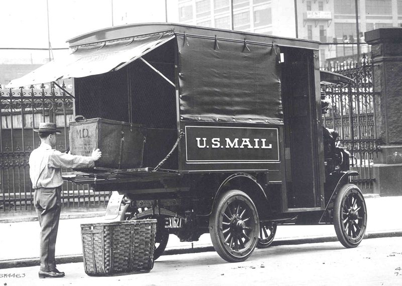 Autocar Truck, Ca. 1914 A Letter Carrier Loads Mail Into