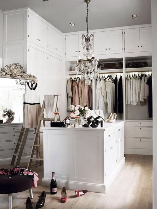 open white closet with chandelier