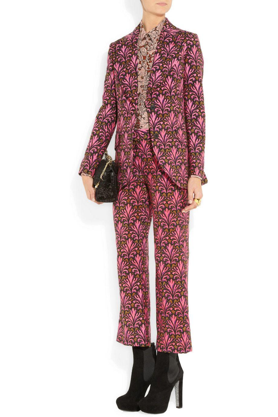 Miu Miu jacket, pants, top, and boots.  Dolce & Gabbana bag.