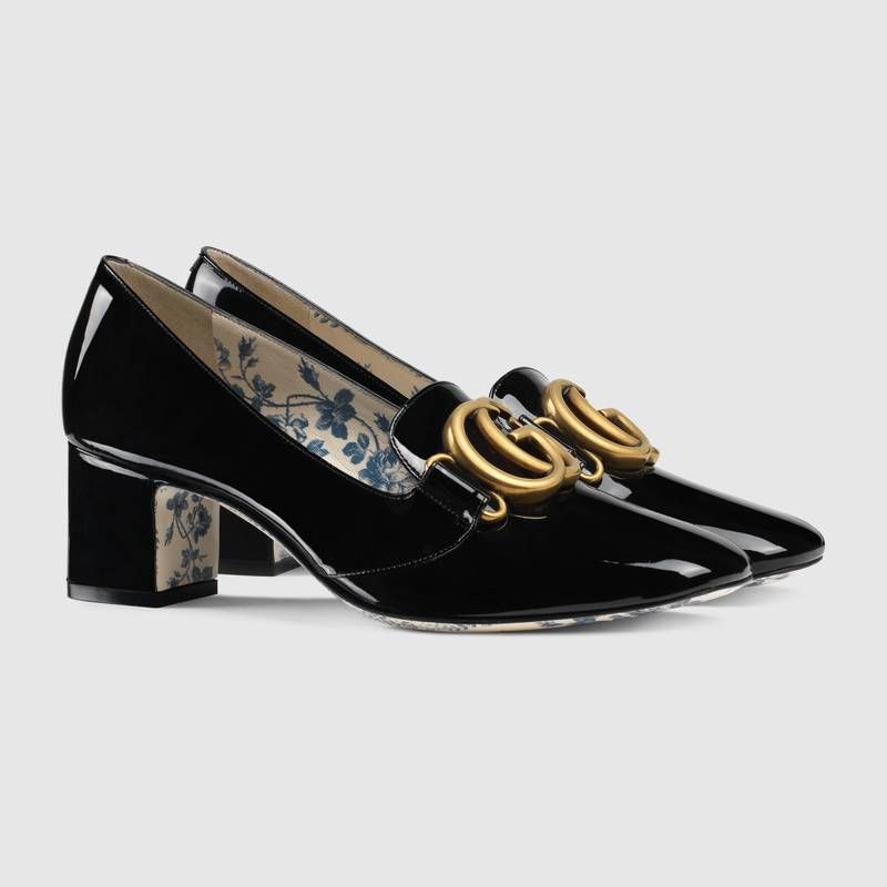 8adcbb3fb92 Shop the Patent leather mid-heel pump with Double G by Gucci. An emblem of  the GG Marmont line