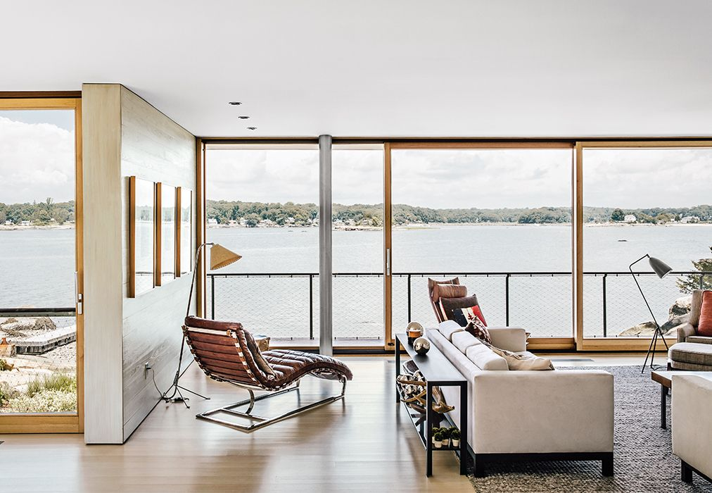 A Desiron Sofa And A Chaise Lounge From Restoration Hardware Furnish The Living  Room At This Historic Connecticut Vacation Home Overlooking The Water.