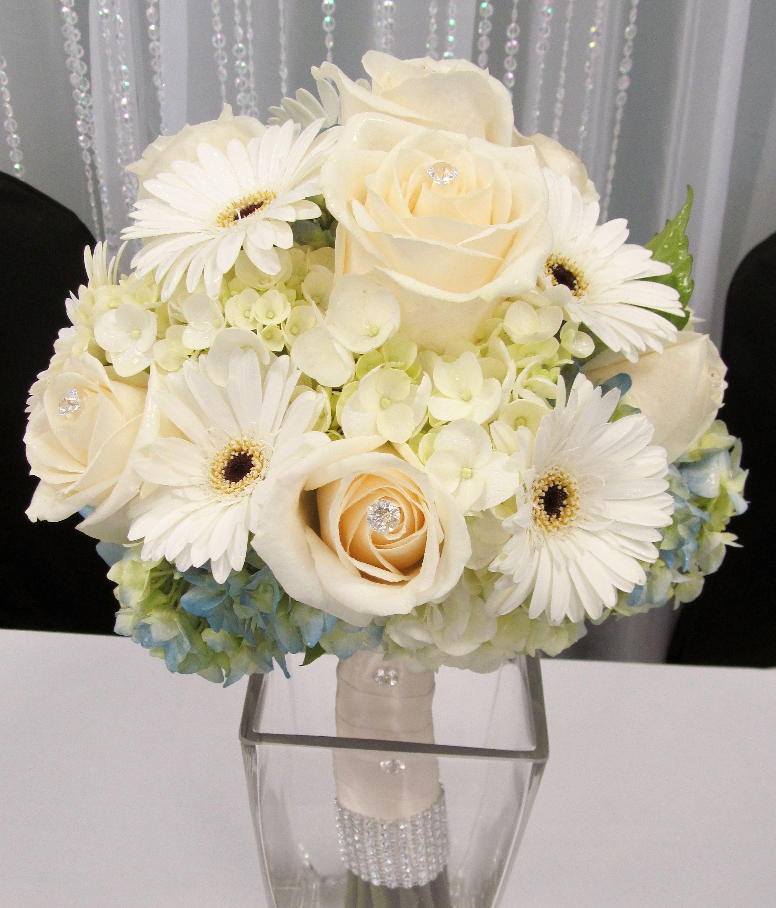 Hydrangea, gerbera daisy and roses.