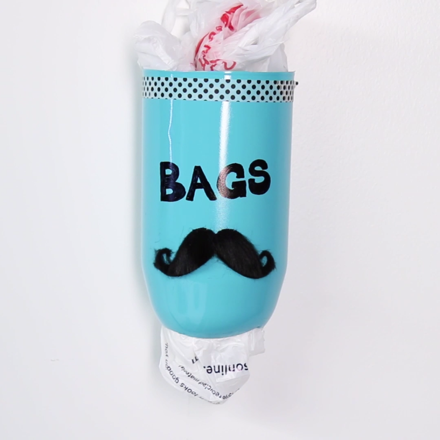 Turn A Two Liter Bottle Into A Pretty Garbage Bag