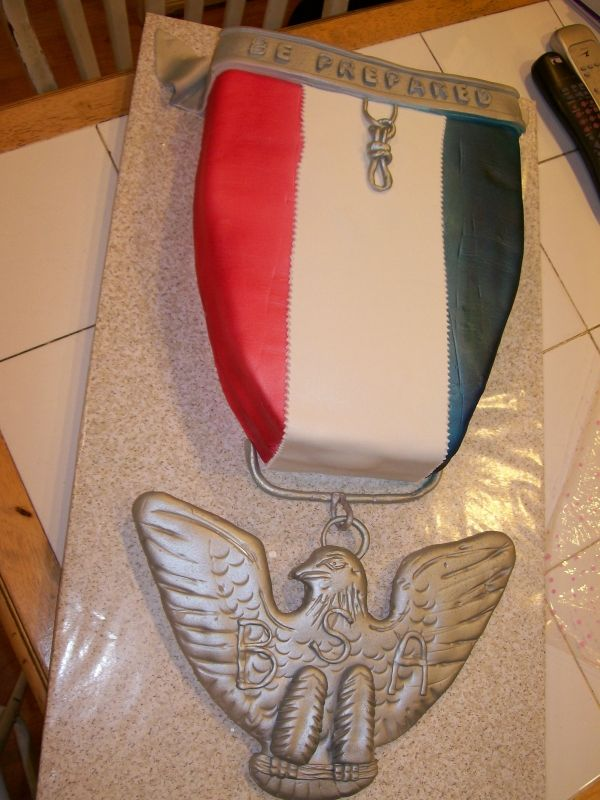 Eagle Scout Medal  Copied from a medal from the Scouts. The eagle was hand carved from fondant on a foamcore board. This cake was nearly 3 feet long!