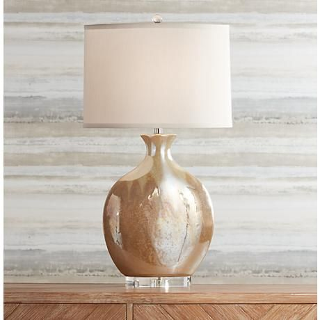 The Ivory Drip Ceramic Glaze, And Oval Lamp Shade, Provide A Clean And  Fancy Design To This Contemporary Ceramic Table Lamp.