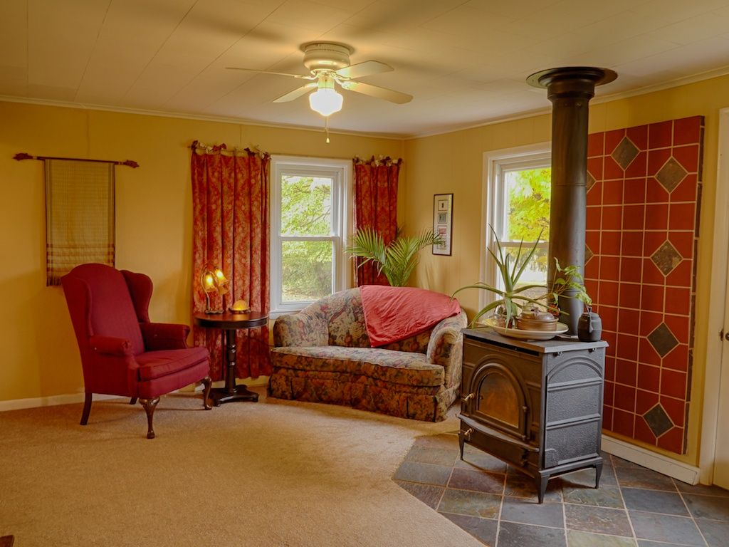 yellow walls, red furnishings, wood stove, slate and terracotta