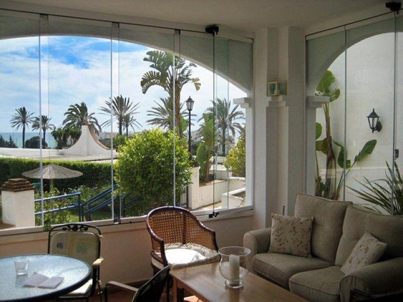 Ventanas para arcos cortina cristal para arcos seeglass for Cortinas para cristales